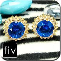 Circular cufflinks with blue crystal
