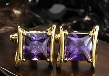 Gilded cufflinks with purple crystal